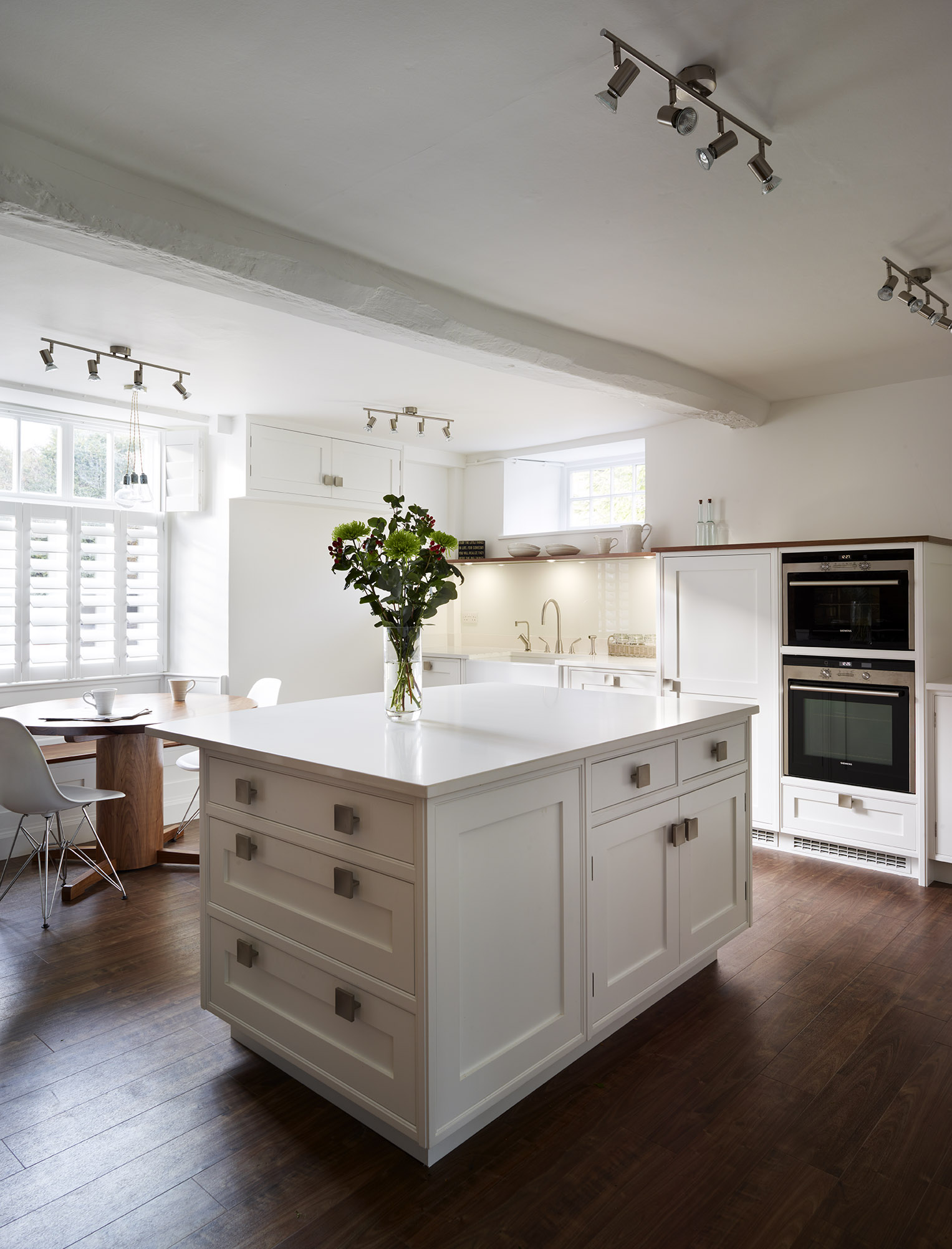 Stoke Goldington - Light kitchen island with contrasting wooden flooring