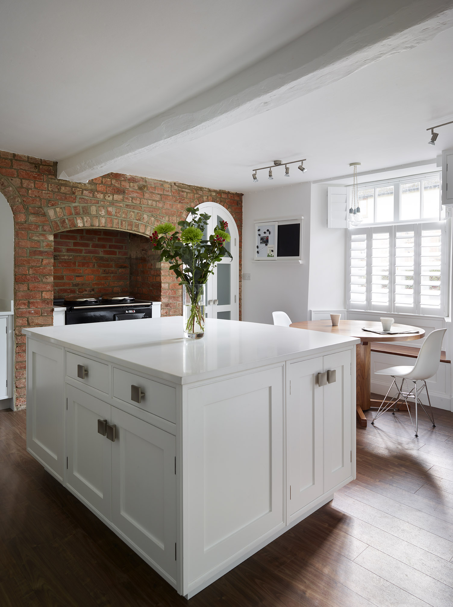 Stoke Goldington - Light kitchen island with contrasting exposed brick wall