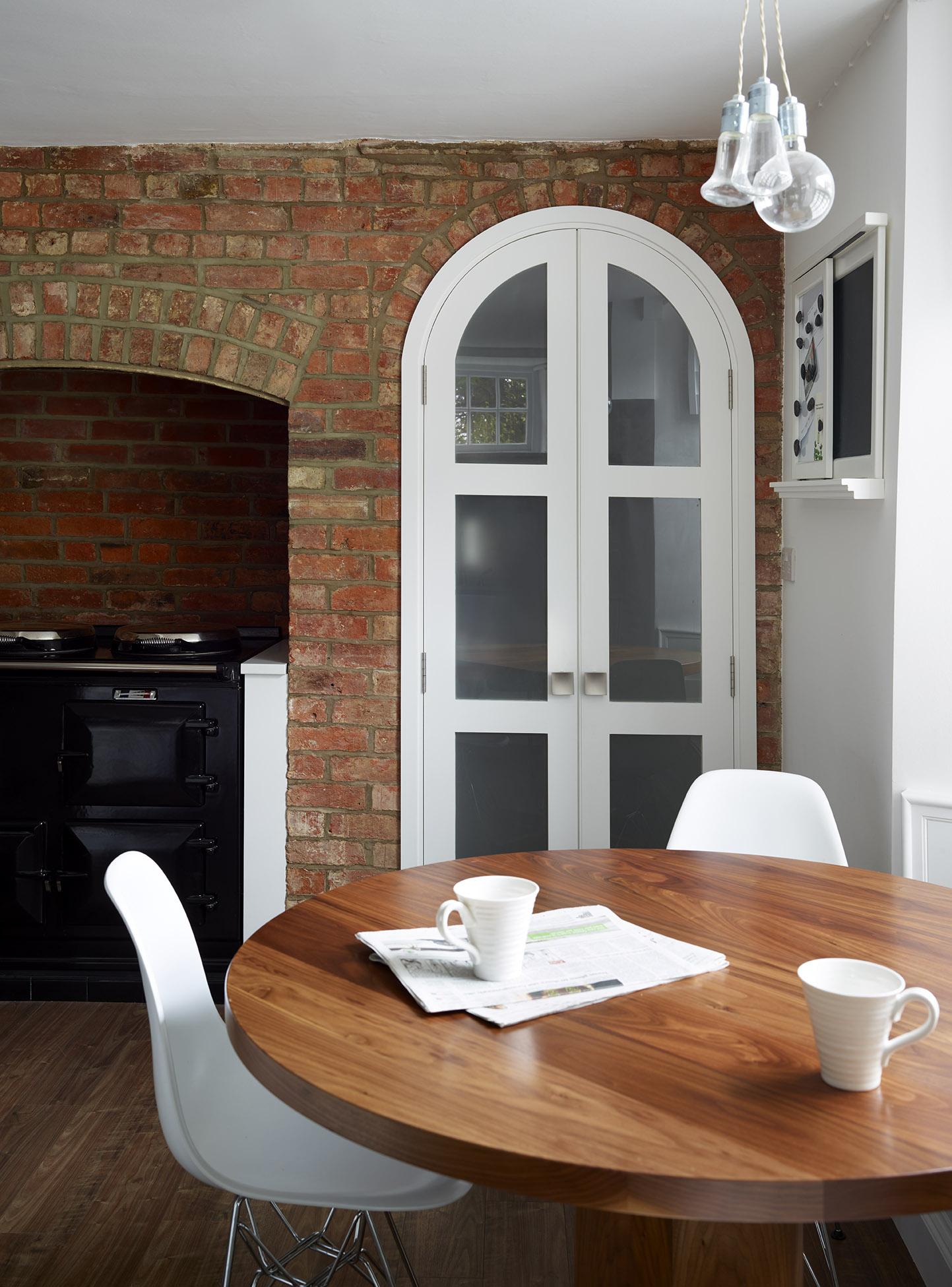 Stoke Goldington - Modern circular walnut table in 18ᵗʰ century cottage