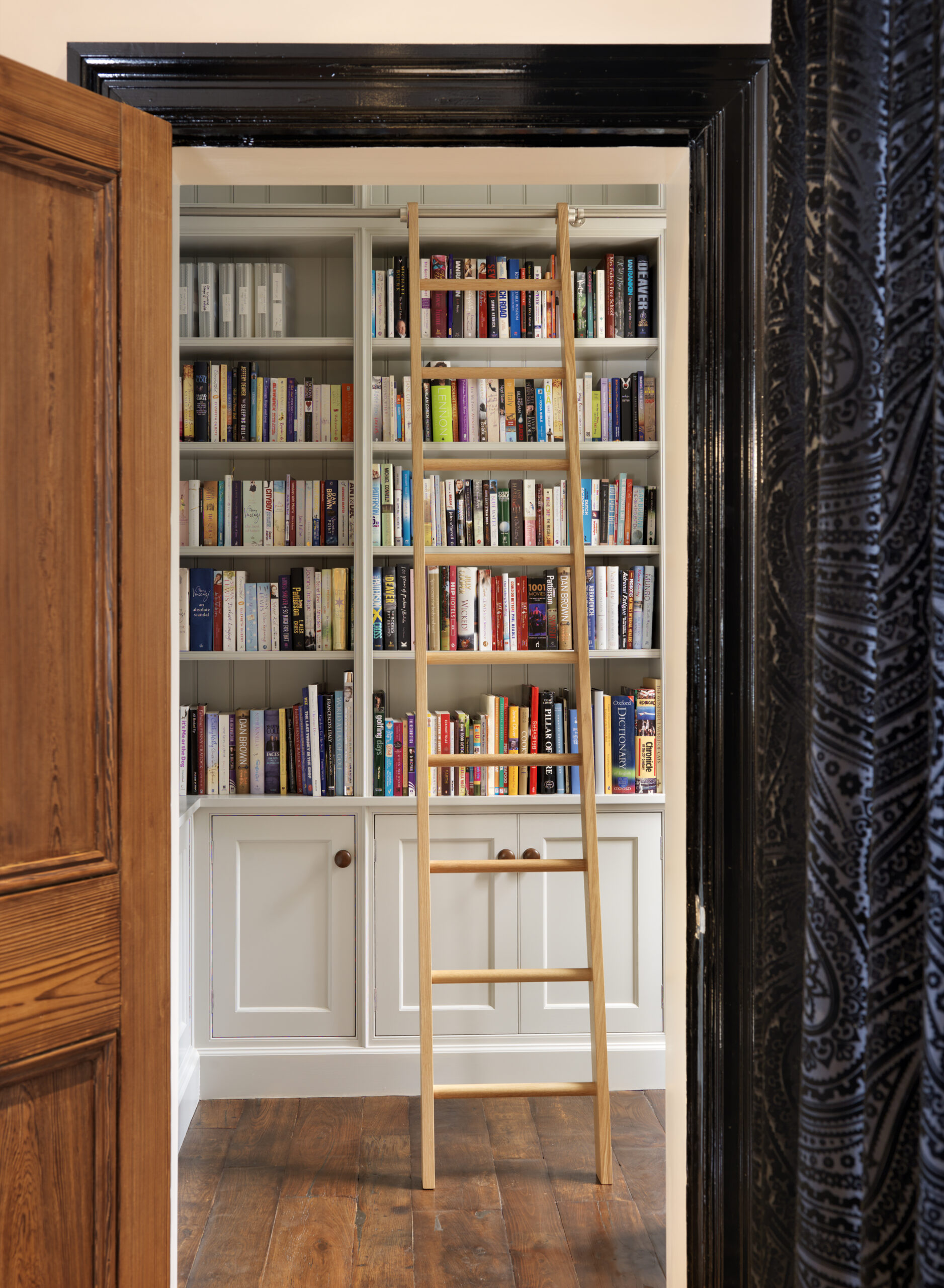 Bespoke Bookshelves With Ladder Rail